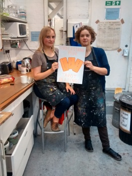 Rosalie and Jo collaborating to make posters for Tarot Readings and The Stone of Wisdom at Inland Art Festival
